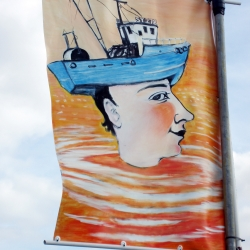 Hand Painted Flags on Harbour Wall Ullapool for Loopallu Music Festival